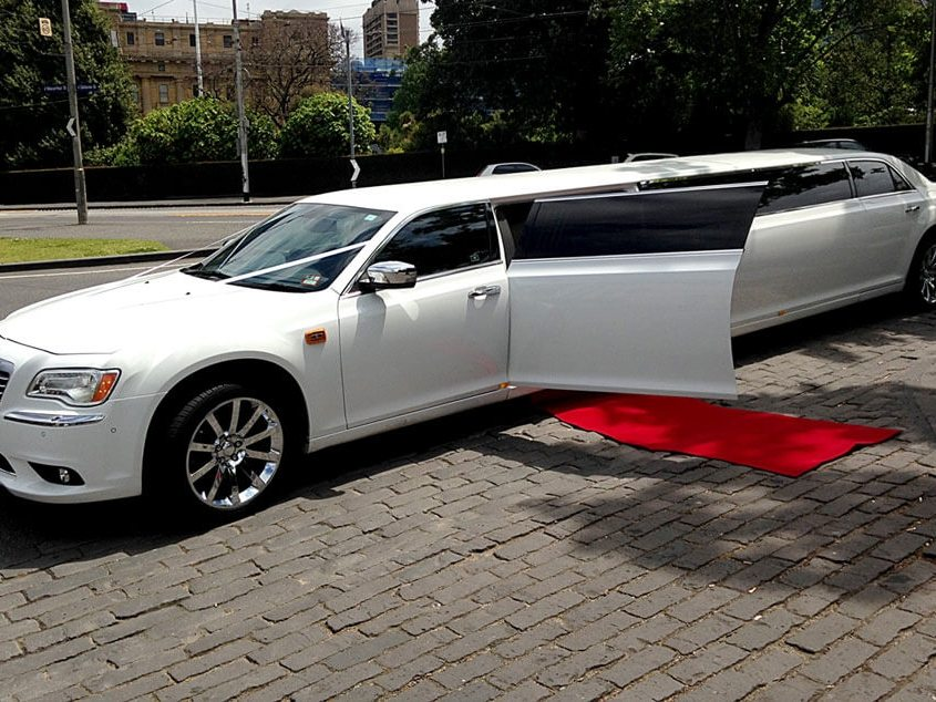 White Chrysler Wedding Limo