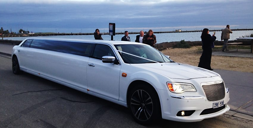 White Chrysler 12 seater limo hire